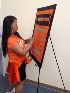 YWCA staff signing Pledge Against Racism at Seneca site and sporting orange in support!