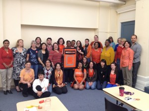 Persimmon Power! YWCA Seneca staff and clients standing against racism (ok, so some are technically sitting).