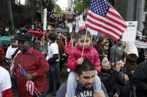 A young May Day protester rides atop her father's shoulders as the march reaches downtown.  Photo credit, Seattle Times.