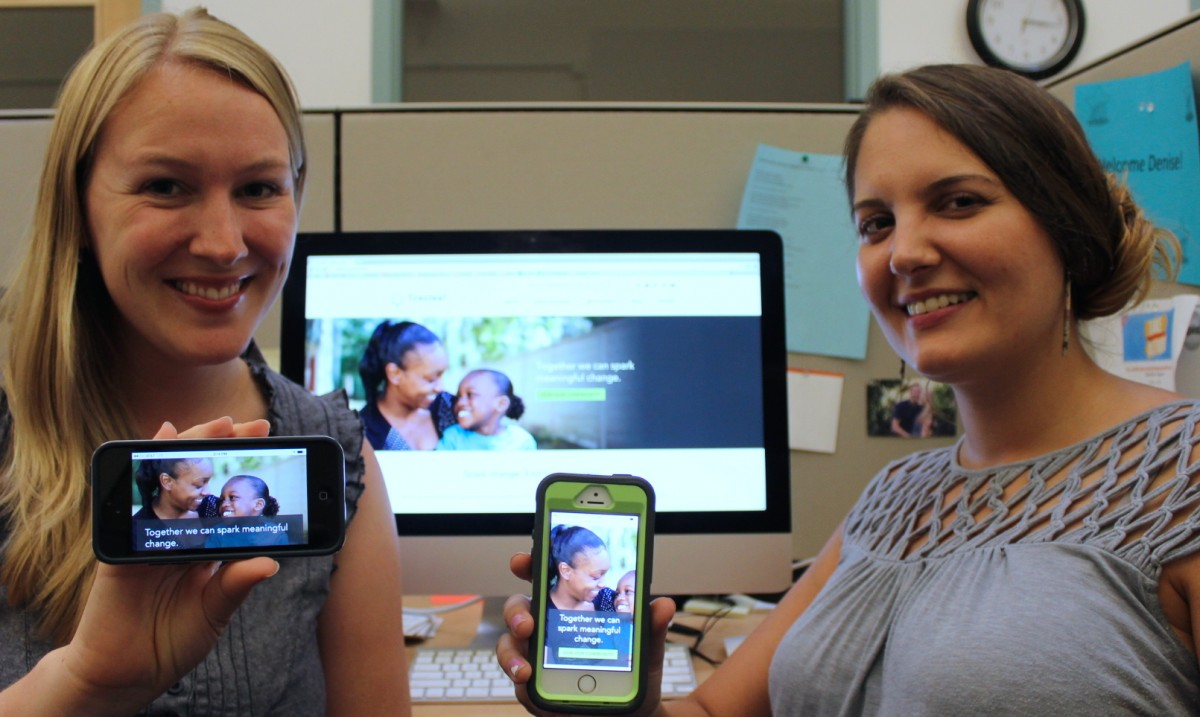 Denise Miller (left) and Erin Murphy show off the mobile-friendliness of the new Firesteel website. Image by Stephanie Heffner.