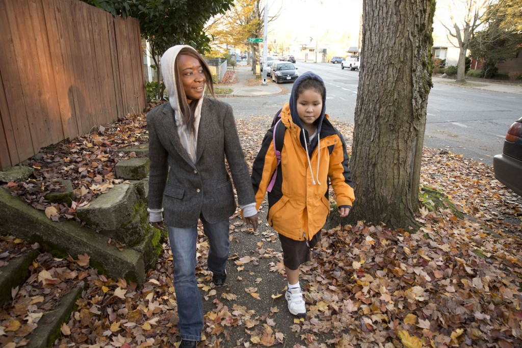 Andrea walks Zoe to school.