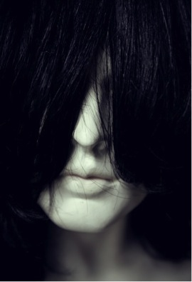 Image 4. Woman's face covered by hair