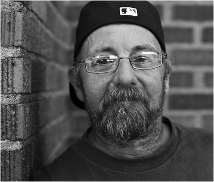 A portrait of Loyd Hogan from the Homeless in Seattle Facebook page. Loyd is a photographer himself, and seeks to continue his passion of nature photography.