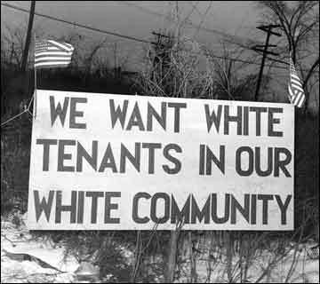 This photo is from long ago, but our country still ends up with predominantly white communities, as well as communities that cluster along other race lines. Image from gibberellins.blogspot.com.