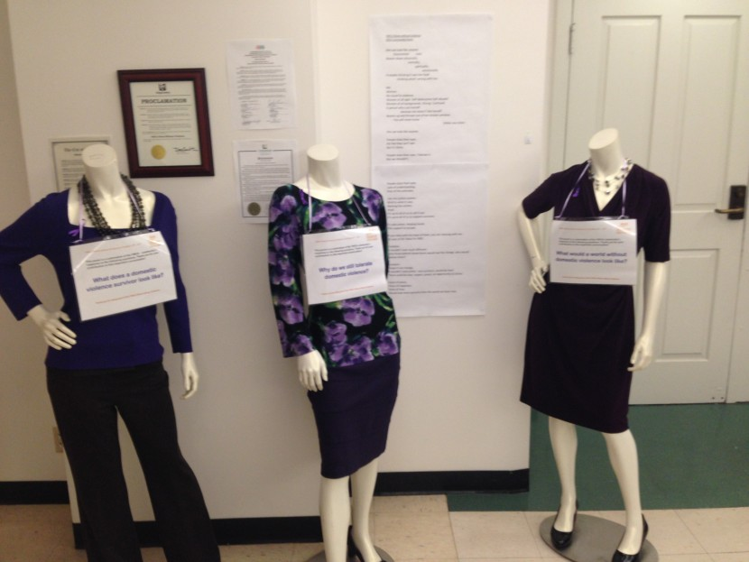 In the lobby of the downtown Seattle YWCA building, purple-clad mannequins invite passersby to read a community poem about domestic violence.