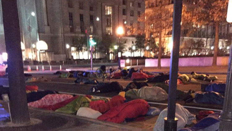 "A ""Sleep Out"" in Washington, D.C.'s Freedom Plaza during Hunger & Homelessness Awareness Week in mid-November. Photo Credit: Laura Tarnosky, <a href=""http://streetsense.org/article/covenant-house-advocates-freedom-plaza-sleep-out-previews-vigil/#.VlzIkmSrRz9"" target=""_blank""><span class=""s1"">Street Sense.</span></a>"