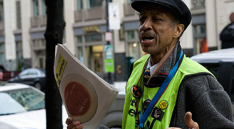 One of the enthusiastic and hardworking vendors for Street Sense, Washington, D.C.'s street paper. Photo by Street Sense, Flickr.